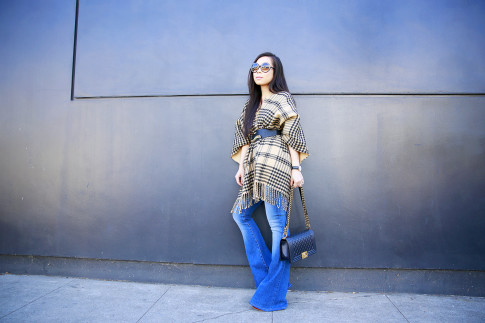 An Dyer wearing Morning Lavender Poncho, Hudson Mia Flares and Guess Belt