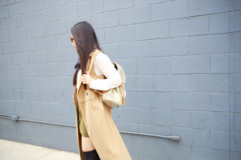 An Dyer wearing Sleeveless Trench Duster, Harper Ave Mini Le Corb Shiny Backpack