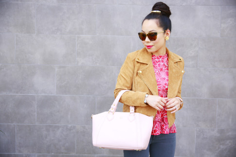 An Dyer wearing mykitsch bun pin with Forever 21 Suede Jacket and Ora Delphine Breast Cancer Awareness Bag