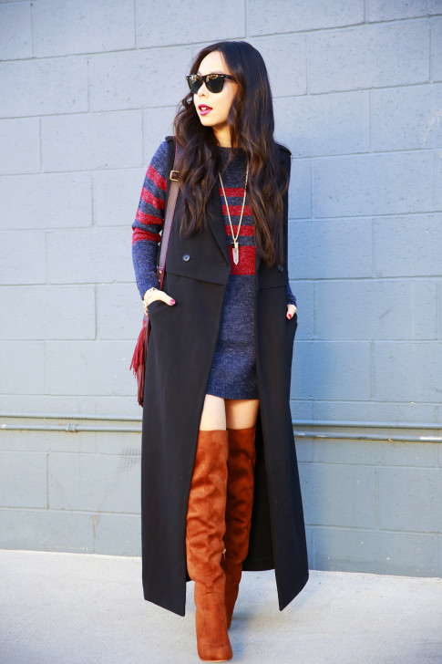 An Dyer wearing Black Long Duster Vest Coat JustFab Sweater Dress Cognac Over The Knee Boots
