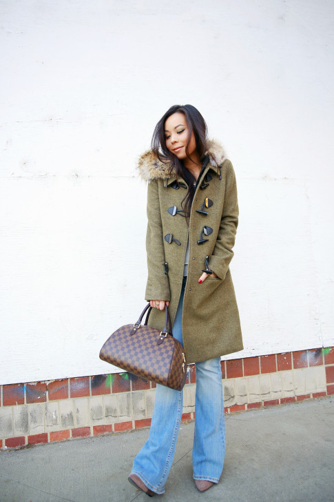An Dyer wearing Dawn Levy Waverly Green Coat, Louis Vuitton Ribera Mm Damier Tote, Aeropostale Light Wash Flare Jeans