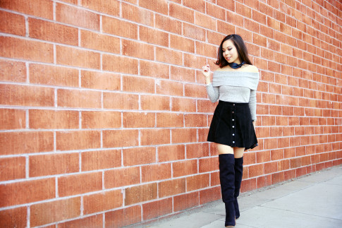 An Dyer wearing Hermes Neck Scarf, Grey Off the Shoulder Sweater Suede Button Front Skirt and OTK Boots