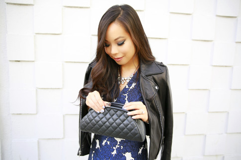 An Dyer carrying Chanel Quilted Kisslock Clutch