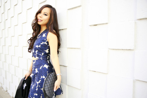 An Dyer wearing Lucy Paris Floral Crop Top and Skirt with Chanel Kisslock Clutch