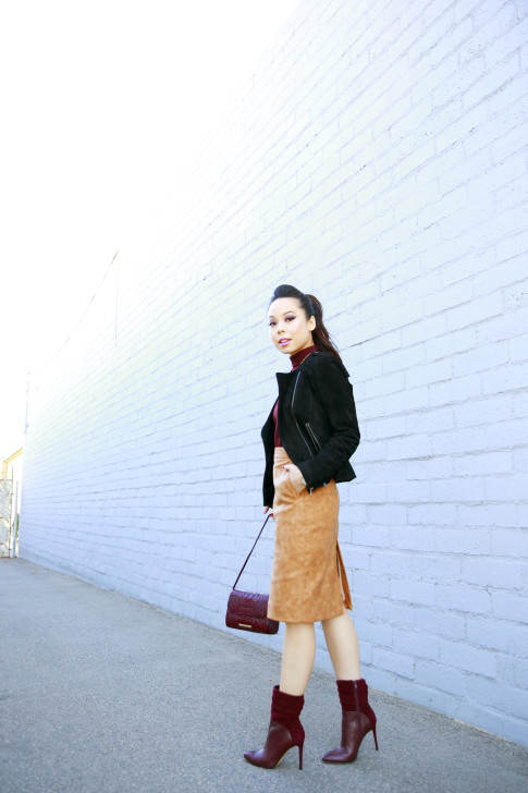 An Dyer wearing Pompadour Ponytail, Forever 21 Suede Jacket, House of CB Skirt, Guess Vvidlet Boots, Brahmin Bag