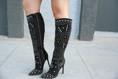 An Dyer wearing Shoedazzle Reita Studded Boots