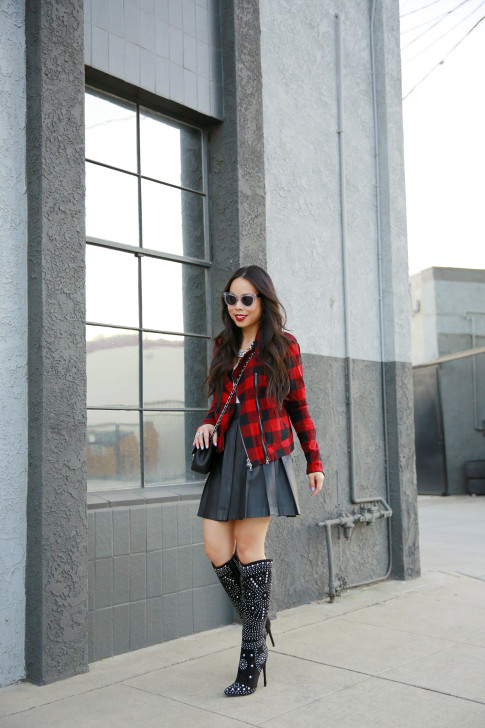An Dyer wearing Shoedazzle Suede Studded Boots, Guess Marciano Leather Pleated Skirt, Hudson Red Plaid Jacket