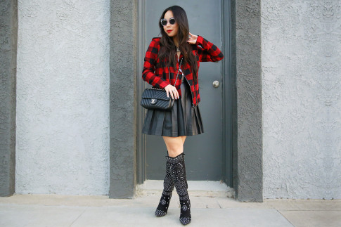 An Dyer wearing Suede Studded Boots, Guess Marciano Leather Pleated Skirt, Hudson Red Plaid Jacket
