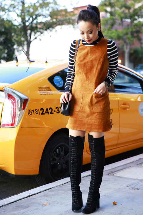 An Dyer wearing Ted and Muffy Black Suede Lace Up Over The Knee Boots, Chanel Bag Earrings