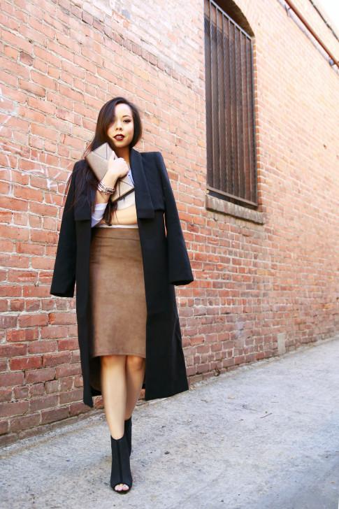 An Dyer wearing Cuyana clutch, Ro&DeNoir SIENNA COAT & Level 99 Tan Suede Skirt