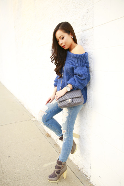 An Dyer wearing Marine Blue Chic Wish Off The Shoulder Sweater with Distressed Jeans