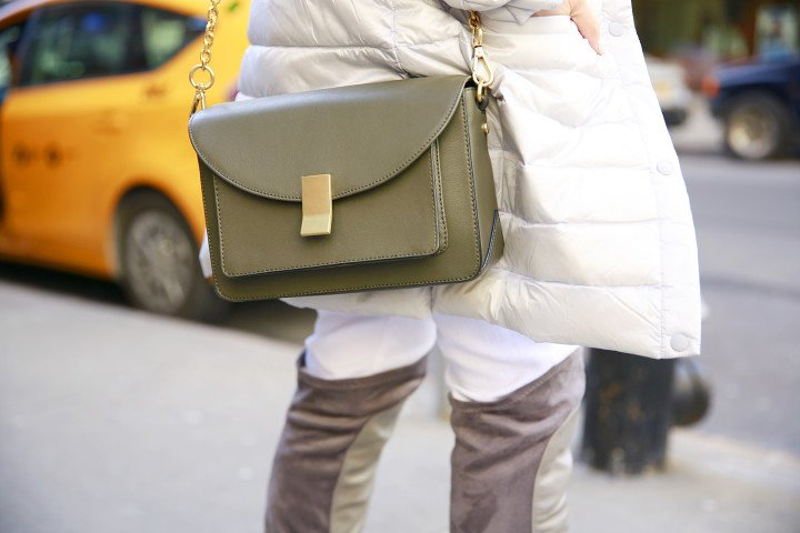 An Dyer carrying Flynn Olive Satchel Bag