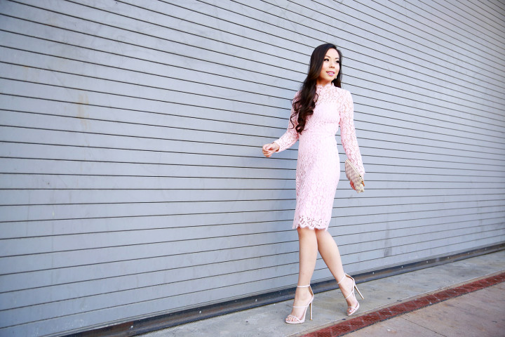 An Dyer wearing Chicwish Pink Long Sleeve Lace Midi Dress with nude strappy sandals