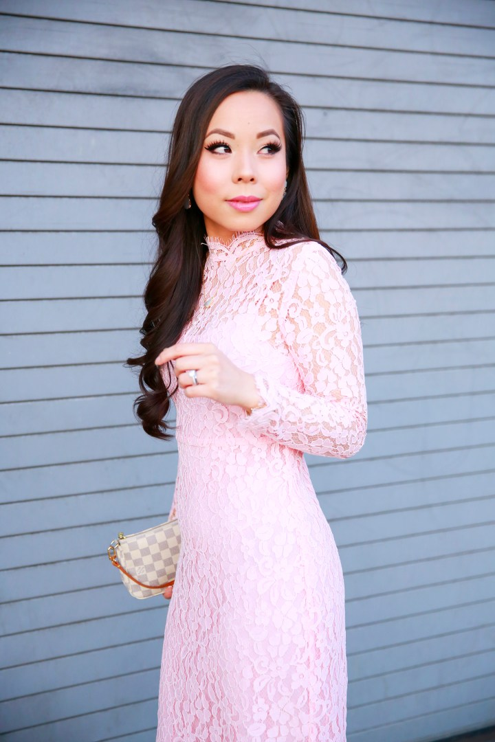 An Dyer wearing Chicwish Pink Long Sleeve Lace Midi Dress