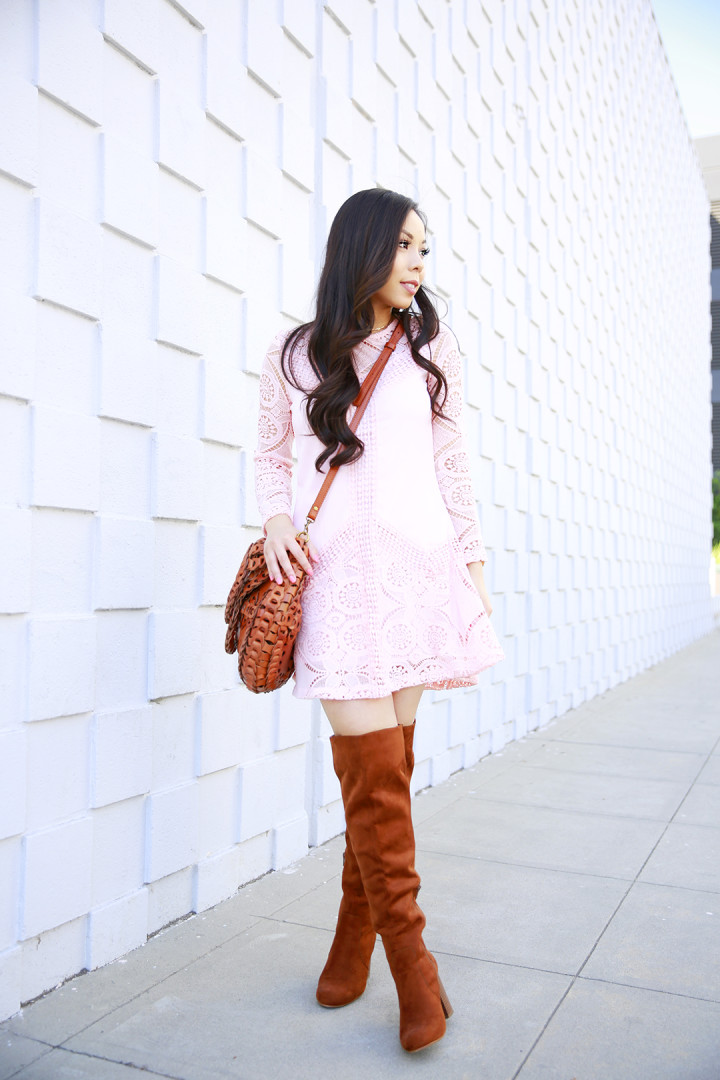 An Dyer wearing Chicwish Pink Blush Crochet Dress with Cognac Over The Knee Boots