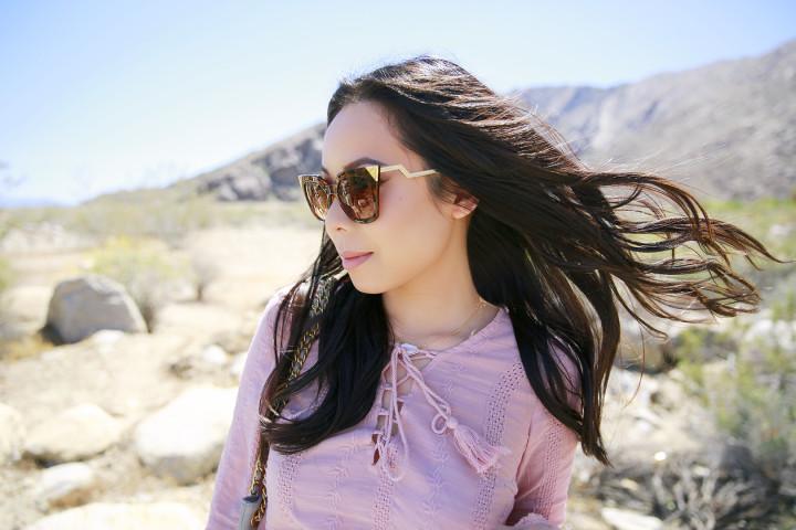 An Dyer Coachella 2016 wearing Charming Charlie Sunglasses