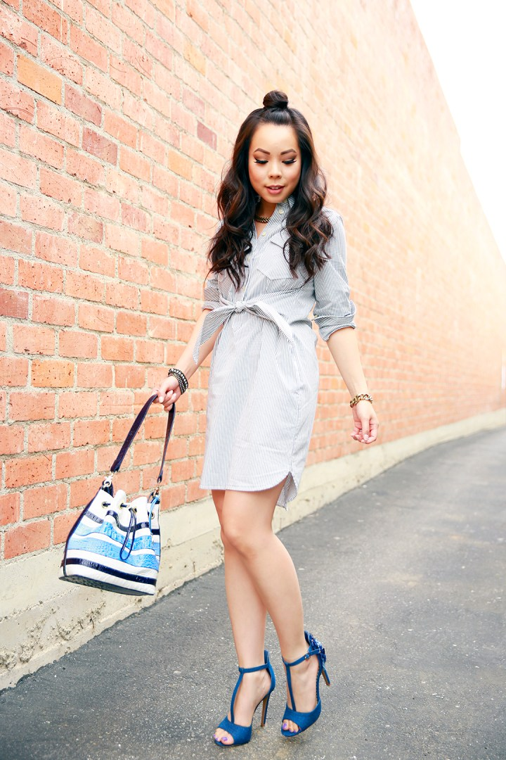 An Dyer in a Samurai Bun wearing Madewell Shirtdress with Brahmin Maxine Bucket Bag