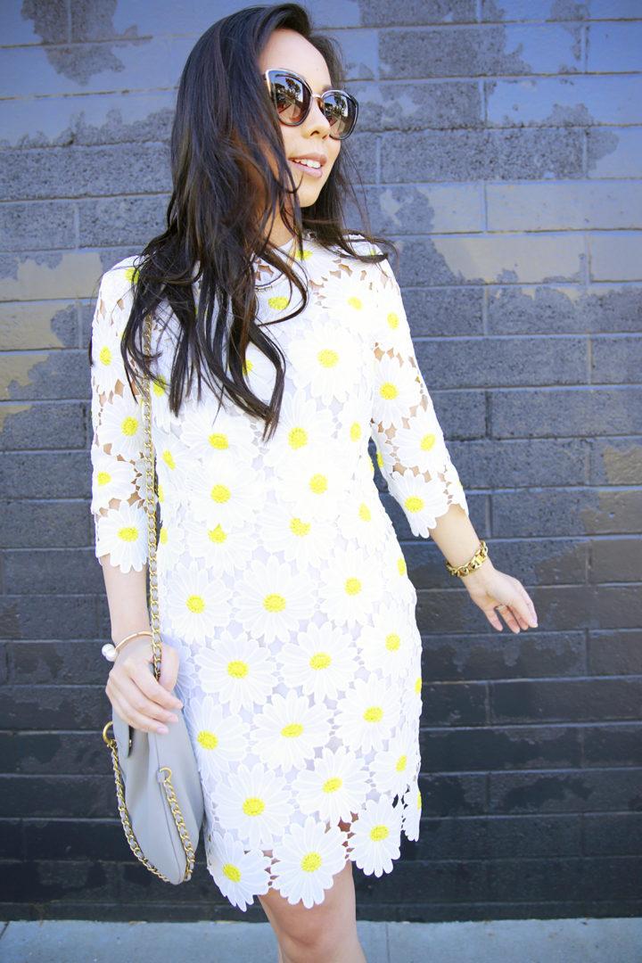 An Dyer wearing Chicwish Crochet Daisy Dress in white