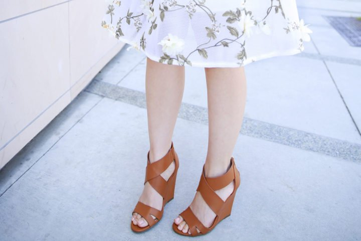 An Dyer wearing Camel Cognac Tan Cross Front Wedge Sandals
