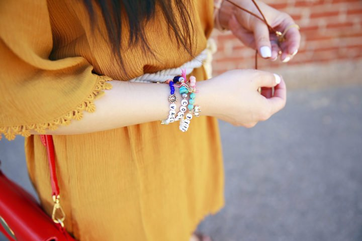 An Dyer wearing beaded Capwell Co bracelets tipsy vacation