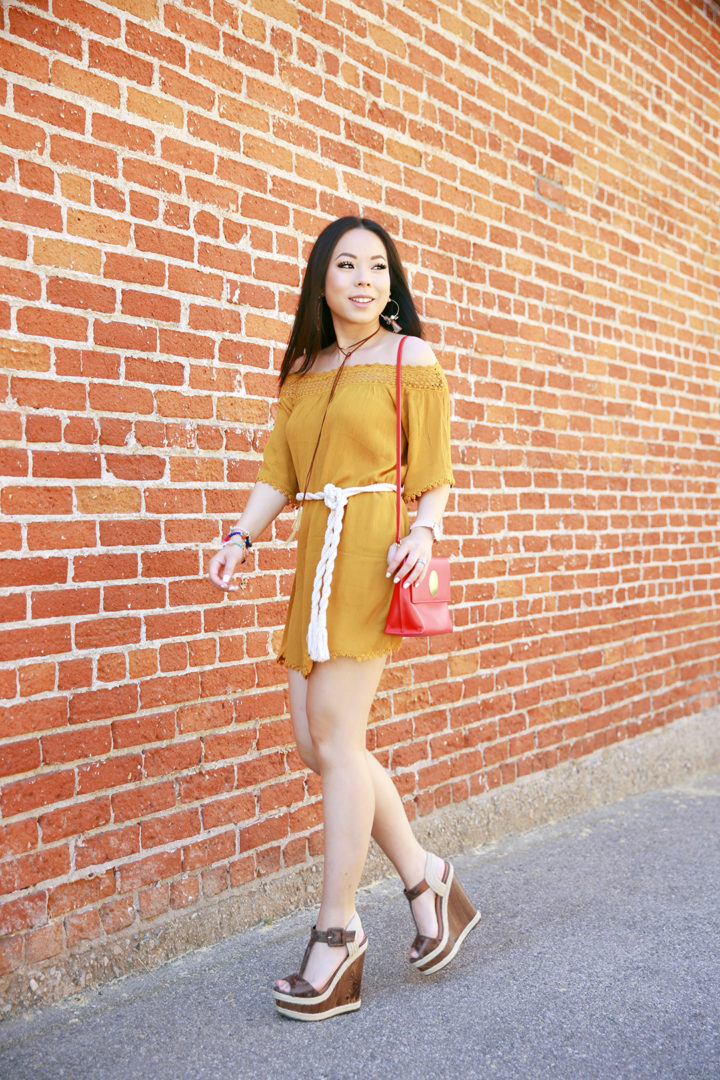 An Dyer wearing mustard yellow off the shoulder dress, rope tie waist belt, chocker necklace, platforms