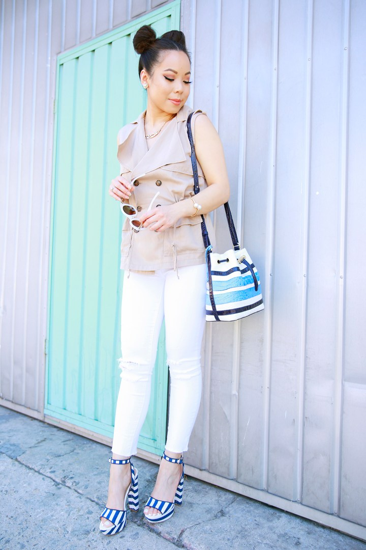 An Dyer wearing Dittos Distressed White Jeans with Trench Top c