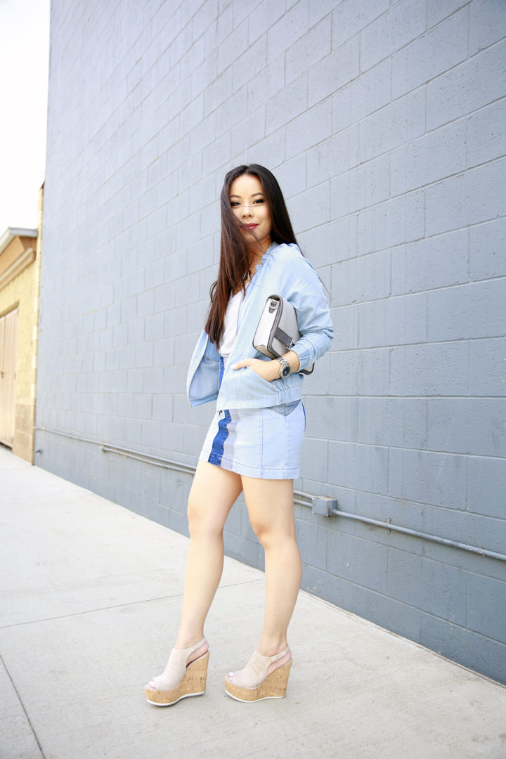 An Dyer wearing Fabletics Chambray Jacket, Guess Patchwork Denim Skirt with Platforms