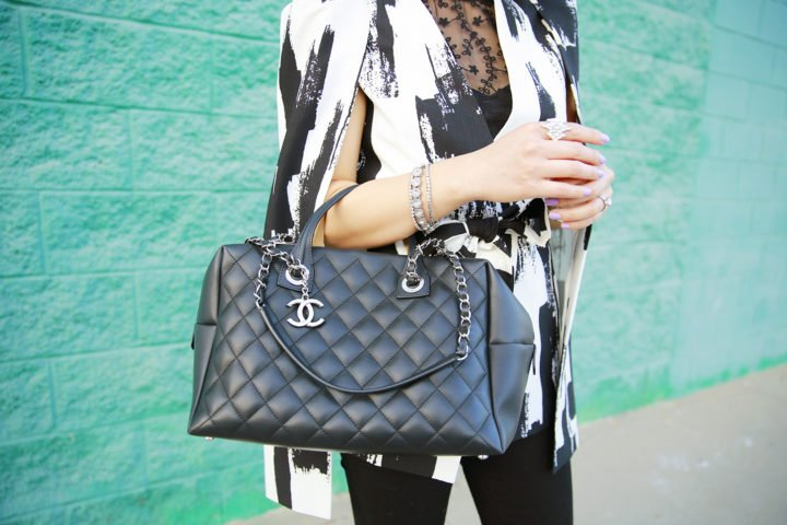 An Dyer carrying Chanel Bowler Bowling Bag