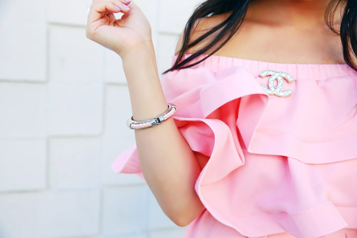 An Dyer wearing Chanel Brooch with Pink Ruffly Dress