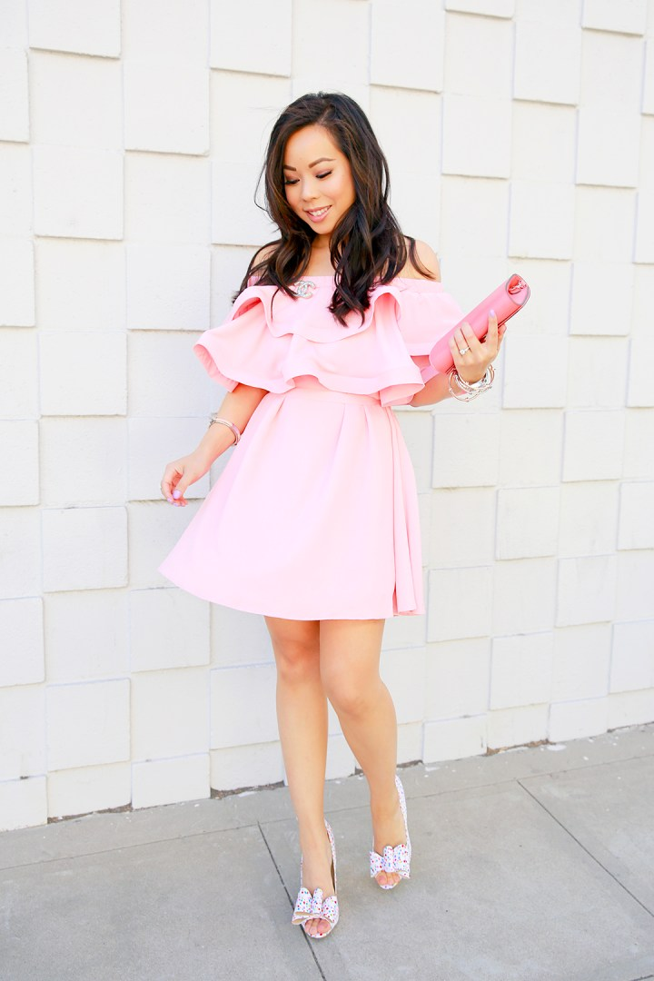 An Dyer wearing Pink Ruffled Off Shoulder Chicwish Dress with Chanel Brooch and Louis Vuitton Louise Corail