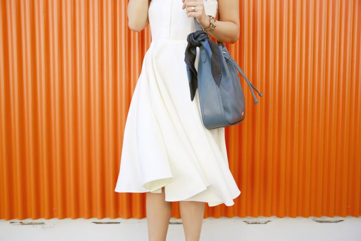 An Dyer wearing Sarah Seven Dress with Hermes Twilly