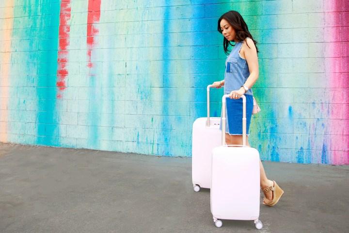 An Dyer wearing Denim Dress with Raden Luggage