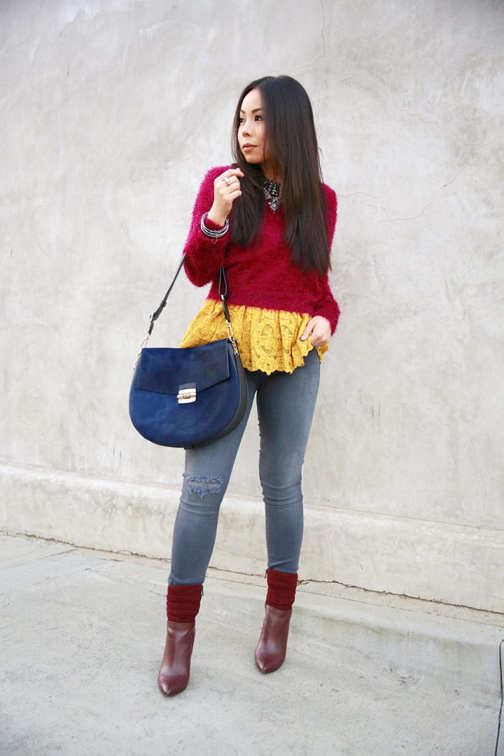 an-dyer-wearing-ella-moss-olivier-lace-camisole-top-layered-under-fluzzy-sweater-hudson-jeans-and-furla-club-in-navy