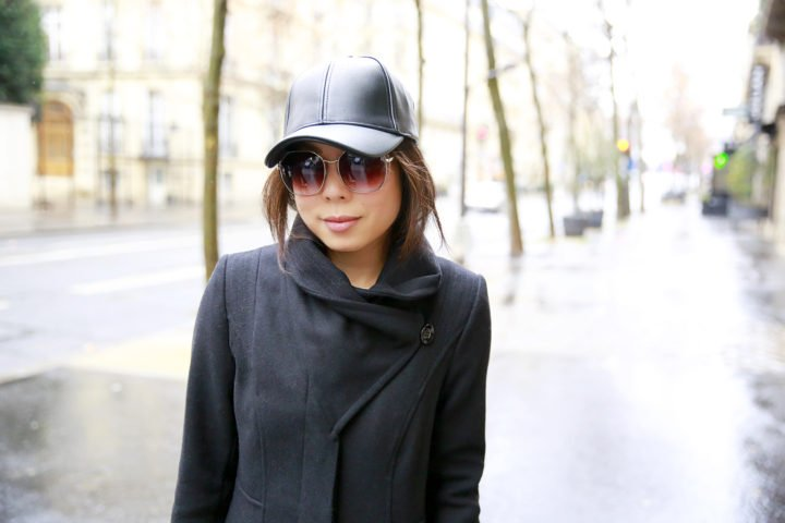 an-dyer-wearing-faux-leather-baseball-cap-with-guess-coat-paris-street-style