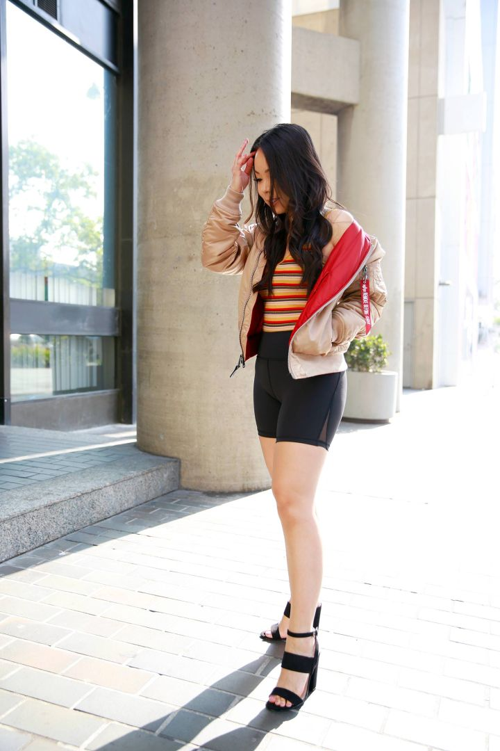 Fashion Blogger An Dyer wearing bike shorts with Alpha Industries jacket