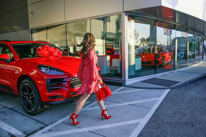 Fashion Blogger An Dyer at Downtown LA Porsche with Carmine Red Macan S Gift Bow