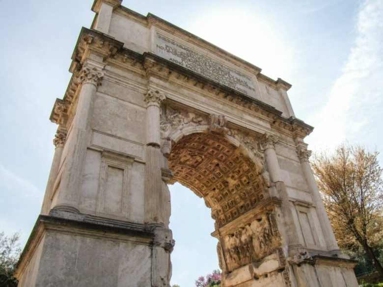 The Arch of Titus was built in 82 A.D. It is the inspiration for the Arc de Triomphe in Paris.