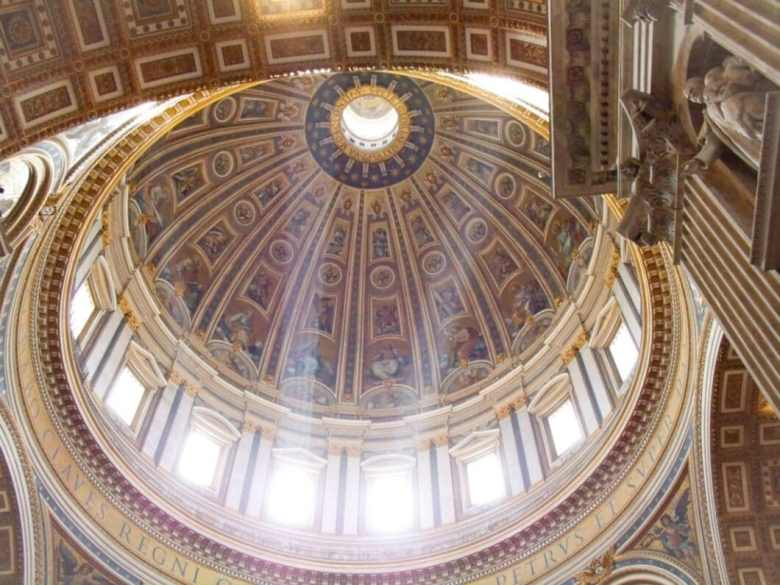 The inside of the dome of St. Peter's Basilica.