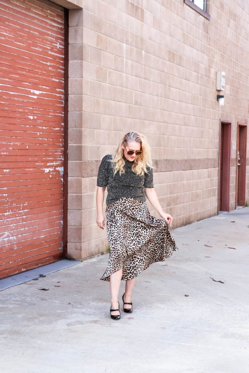 Styling this leopard print midi skirt 5 ways on Have Need Want! If you're looking for some outfit Inso head over to the post to check it out! #stylingtips #leopardprint #leopardprintmidiskirt #midiskirts