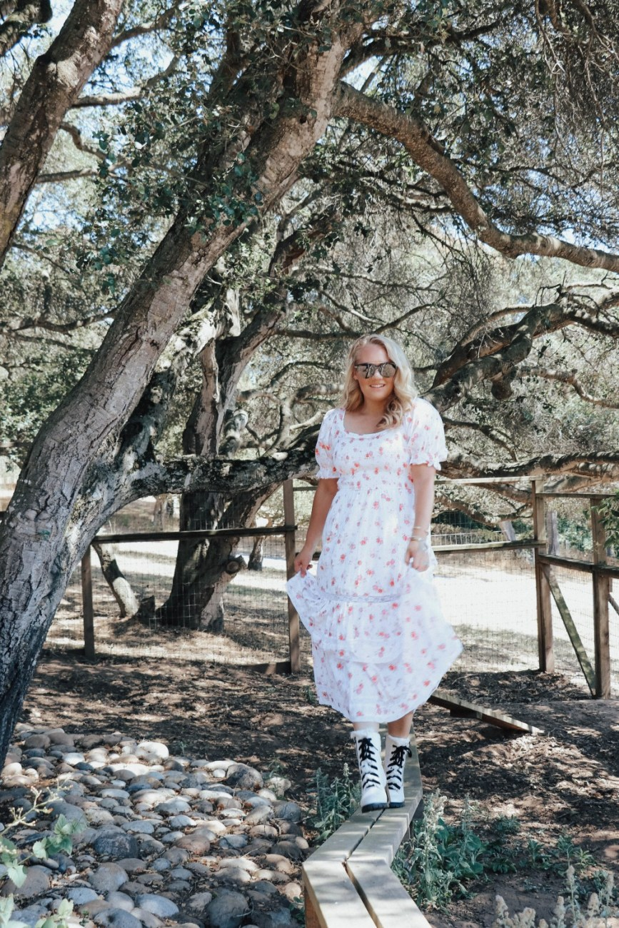 How to style white combat boots in summer. Head over to the blog to get my styling tips. #whitecombatboots #summeroutfit #summerstyle #floraldress #mididress
