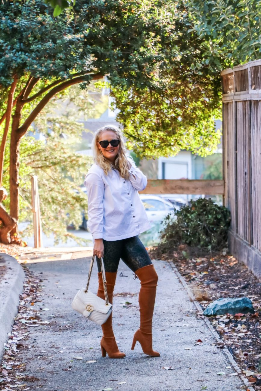 Styling my Spanx faux leather leggings with a white button down shirt and over the knee boots. #otkboots #fauxleatherleggings #falloutfit #momoutfit