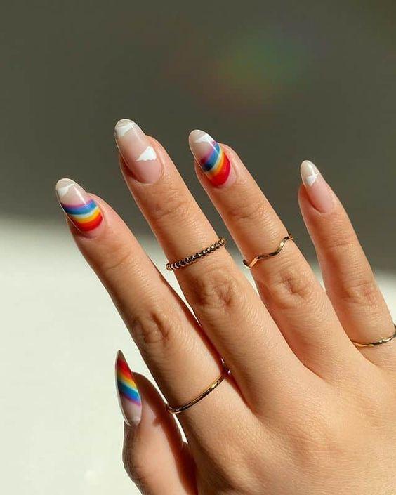 Rainbow and cloud nail art