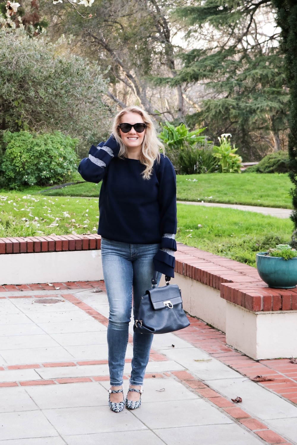 Wearing a Statement Sleeve Sweater is an Easy Way to Look Chic With not Much Effort! Click on the Photo to Check out the Post! | Have Need Want. #statementsleeves #statementsleevesweater #winterstyle