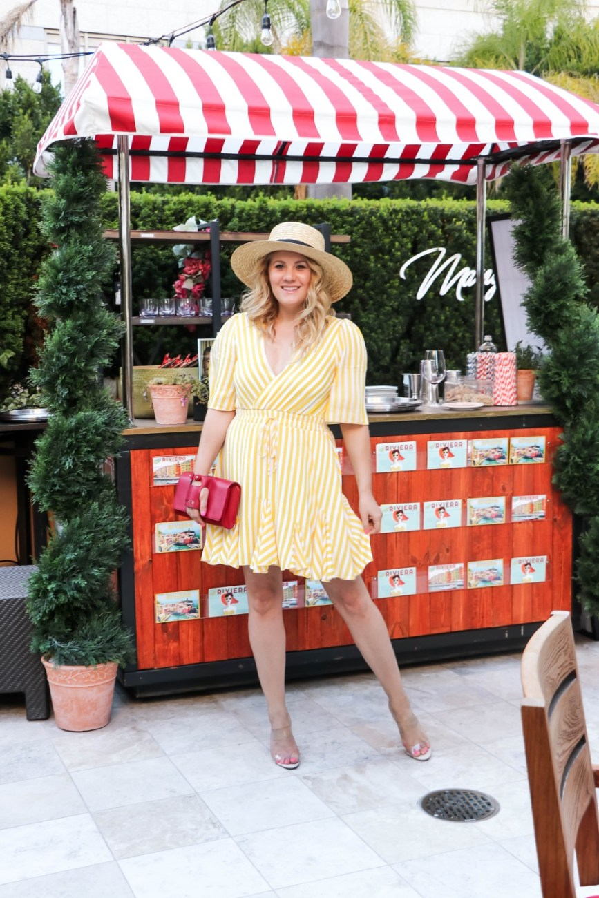 The cutest yellow stripe dress that's under $25 on Have Need Want today! Head on over to the post to check out the full look + get outfit details and where to shop this must have dress for summer! #summerdress #summerdresses #summeroutfits #summerfashion #dressoutfits #vacationoutfits #rivierastyle #strawhat #schutzheels #vacationstyle