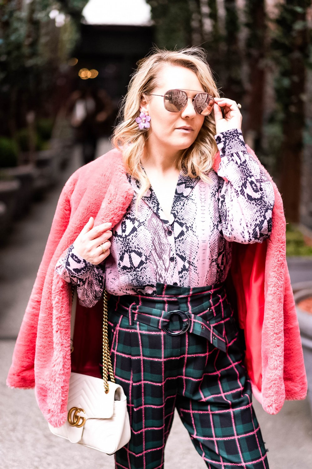 Print Mixing with a Snakeskin Print Blouse and Plaid Pants on Have Need Want! Click on the photo to check out the full post + get my outfit details! #NYFW #streetstyle #printmixing #outfitdetails #winterstyle