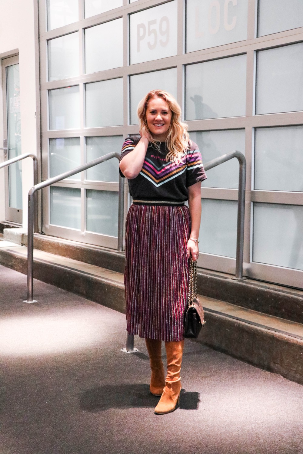 Day Three of NYFW I Wore This Vintage Inspired Wrangler Tee and Multi-Metallic Skirt From Topshop! Click on the photo to check out the full post on Have Need Want! #NYFW #NYFWstreetstyle #Wrangler #Topshop #OutfitInspiration