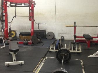 picture of a monolift, platform, and bench press