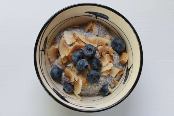 Chia Pudding with blueberries and coconut flakes