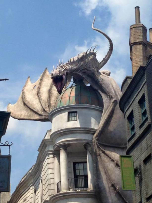 Diagon Alley dragon at Universal Studios Orlando with a toddler