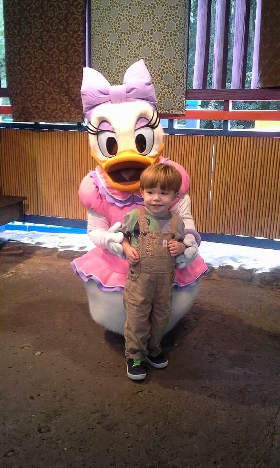Character greetings with a toddler at Walt Disney World meeting Daisy